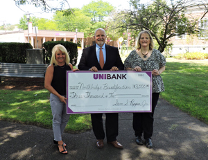 UniBank President Sam Pepper presenting check to Northbridge Beautification co-founders
