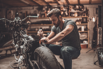 Man working on a motorcycle in a shop